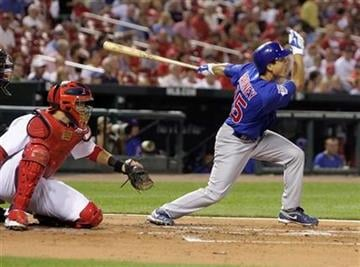 Chicago Cubs' Darwin Barney connects for an RBI single as St. Louis Cardinals catcher Yadier Molina watches in the second inning of a baseball game, Tuesday, Sept. 14, 2010 in St. Louis.(AP Photo/Tom Gannam) By Tom Gannam