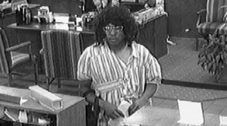 The suspect in these surveillance photos is accused of holding up the Southern Commercial Bank at 3207 Meramec Wednesday around 3 p.m. By Lakisha Jackson