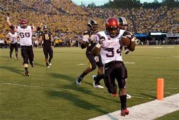 San Diego State running back Walter Kazee, right, scores a touchdown during the first quarter of an NCAA college football game against Missouri on Saturday, Sept. 18, 2010, in Columbia. (AP Photo/L.G. Patterson) By L.G. Patterson