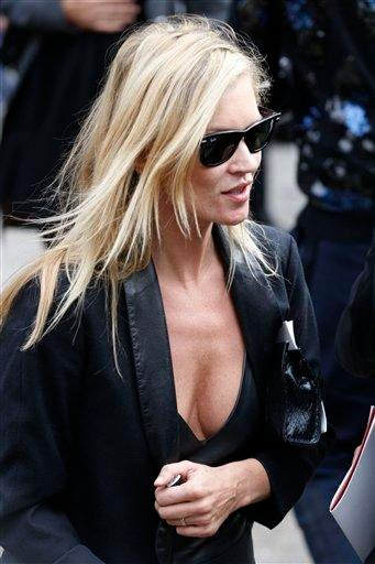 British supermodel Kate Moss after the memorial service for Alexander McQueen at St Paul's Cathedral in London, Monday, Sept. 20, 2010, which took place during London Fashion Week. (AP Photo/Sang Tan) By Sang Tan