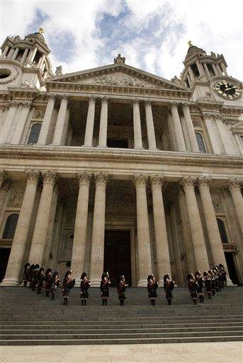 Scottish bagpipers stand on the steps and play outside the memorial service for Alexander McQueen at St Paul's Cathedral in London,  Monday, Sept. 20, 2010, which takes place during London Fashion Week. (AP Photo/Joel Ryan) By Joel Ryan