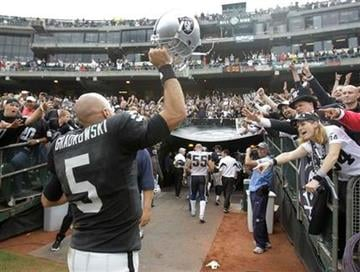 Oakland Raiders quarterback Bruce Gradkowski (5) waves at fans after defeating the St. Louis Rams 16-14 in an NFL football game in Oakland, Calif., Sunday, Sept. 19, 2010. (AP Photo/Paul Sakuma) By Paul Sakuma
