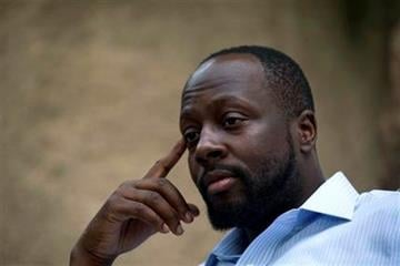 FILE - In this Aug. 18, 2010 file photo, Haiti's presidential candidate and hip hop singer Wyclef Jean, speaks during an interview at his mother's house in Croix de Bouquets, Haiti. (AP Photo/Ramon Espinosa, file) By Ramon Espinosa