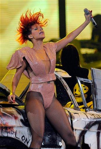 """FILE - In this July 21, 2010 file photo, Rihanna performs during a stop on her """"Last Girl on Earth"""" tour at Staples Center in Los Angeles. (AP Photo/Chris Pizzello, file) By Chris Pizzello"""