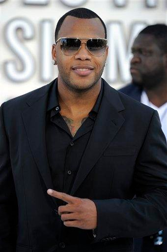 Tramar Dillard, also known as Flo Rida, arrives at the MTV Video Music Awards on Sunday, Sept. 12, 2010 in Los Angeles. (AP Photo/Chris Pizzello) By Chris Pizzello