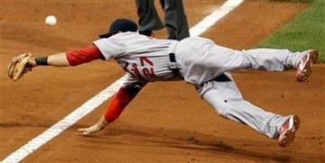 St. Louis Cardinals third baseman Tyler Greene dives for a foul ball by Pittsburgh Pirates' Andrew McCutchen during the sixth inning of a baseball game in Pittsburgh Tuesday, Sept. 21, 2010. The Pirates won 5-2. (AP Photo/Gene J. Puskar) By Gene J. Puskar