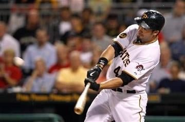 Pittsburgh Pirates' Garrett Jones hits a double to drive in a run in the Pirates' three-run third inning of a baseball game against the St. Louis Cardinals in Pittsburgh, Wednesday, Sept. 22, 2010. (AP Photo/Keith Srakocic) By Keith Srakocic