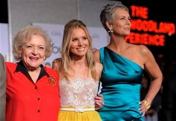 """Betty White, left, Kristen Bell, center, and Jamie Lee Curtis, cast members in """"You Again,"""" pose together at the premiere of the film in Los Angeles, Wednesday, Sept. 22, 2010. (AP Photo/Chris Pizzello) By Chris Pizzello"""