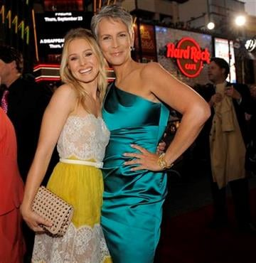 """Kristen Bell, left, and Jamie Lee Curtis, cast members in """"You Again,"""" pose together at the premiere of the film in Los Angeles, Wednesday, Sept. 22, 2010. (AP Photo/Chris Pizzello) By Chris Pizzello"""