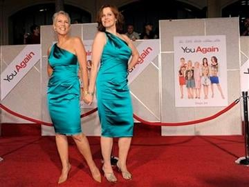 """Jamie Lee Curtis, left, and Sigourney Weaver, cast members in """"You Again,"""" pose together on the red carpet at the premiere of the film in Los Angeles, Wednesday, Sept. 22, 2010. (AP Photo/Chris Pizzello) By Chris Pizzello"""
