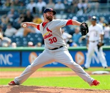 St Louis Cardinals relief pitcher Jason Motte throws against the Pittsburgh Pirates in the 7th inning, Thursday Sept. 23, 2010.  (AP Photo/John Heller) By John Heller