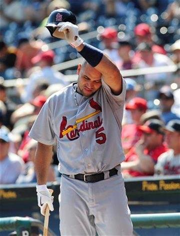 St Louis Cardinals' Albert Pujols wipes his face during the fifth inning of a baseball game against the Pittsburgh Pirates in Pittsburgh, Thursday, Sept. 23, 2010. Pujols hit two home runs as the Cardinals won 9-2. (AP Photo/John Heller) By John Heller
