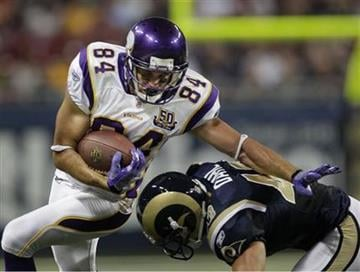 Minnesota Vikings tight end Mickey Shuler, (84)  runs around St. Louis Rams safety Craig Dahl, (43) during the first quarter of a preseason NFL football game Saturday, Aug. 14, 2010, in St Louis. (AP Photo/Jeff Roberson) By Jeff Roberson