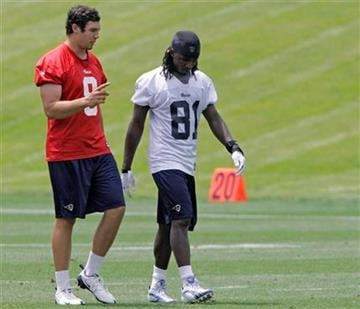 St. Louis Rams quarterback Sam Bradford, left,  talks with wide receiver Mardy Gilyard after practice at a team minicamp, Thursday, June 10, 2010,  in St. Louis.(AP Photo/Tom Gannam) By Tom Gannam
