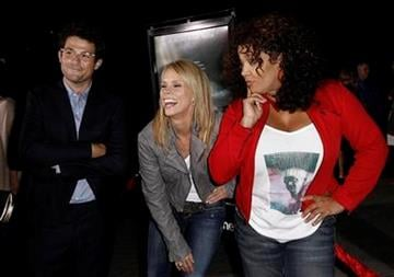"""Actress Cheryl Hines, center, actress Kym Whitley, right, and Jacob Soboroff pose together at the premiere of """"Waiting for 'Superman'"""" in Los Angeles, Monday, Sept. 20, 2010. (AP Photo/Matt Sayles) By Matt Sayles"""