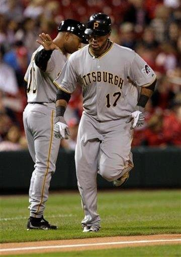 Pittsburgh Pirates' Pedro Alvarez (17) runs past third base coach Tony Beasley after hitting a solo home run in the second inning of a baseball game against the St. Louis Cardinals, Monday, Sept. 27, 2010, in St. Louis.(AP Photo/Tom Gannam) By Tom Gannam