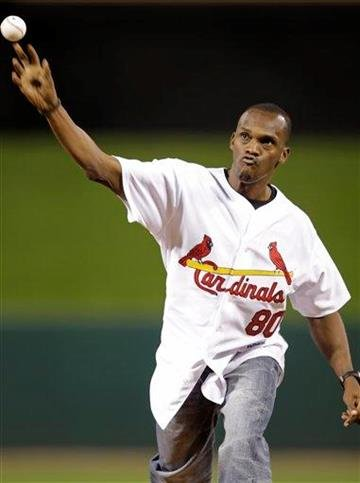 Former St. Louis Rams star Isaac Bruce throws out the first pitch before a baseball game between the Pittsburgh Pirates and the St. Louis Cardinals, Monday, Sept. 27, 2010 in St. Louis.(AP Photo/Tom Gannam) By Tom Gannam