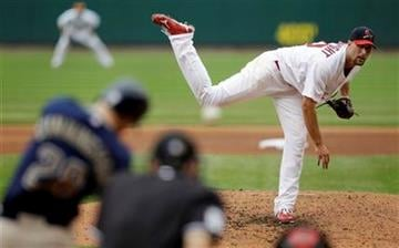 St. Louis Cardinals starting pitcher Adam Wainwright, right, delivers to San Diego Padres' Aaron Cunningham during the fifth inning of a baseball game Sunday, Sept. 19, 2010, in St. Louis. (AP Photo/Jeff Roberson) By Jeff Roberson