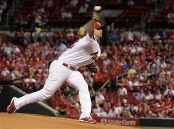 St. Louis Cardinals starting pitcher Adam Wainwright pitches in the first inning of a baseball game, Tuesday, Sept. 14, 2010 in St. Louis.(AP Photo/Tom Gannam) By Tom Gannam