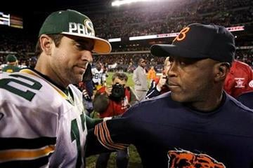 Chicago Bears coach Lovie Smith, right, consoles Green Bay Packers quarterback Aaron Rodgers after the Bears' 20-17 win in an NFL football game Monday, Sept. 27, 2010, in Chicago. (AP Photo/Charles Rex Arbogast) By Charles Rex Arbogast