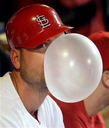 St. Louis Cardinals' Matt Holliday blows a bubble in the dugout in the bottom of the seventh inning of a baseball game against the Pittsburgh Pirates, Tuesday, Sept. 28, 2010 in St. Louis.(AP Photo/Tom Gannam) By Tom Gannam
