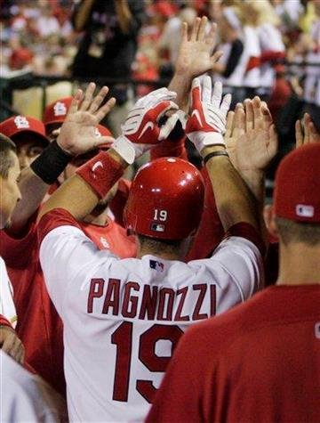 St. Louis Cardinals' Matt Pagnozzi (19) celebrates in the dugout after hitting a solo home run in the second inning of a baseball game against the Pittsburgh Pirates, Tuesday, Sept. 28, 2010, in St. Louis.(AP Photo/Tom Gannam) By Tom Gannam