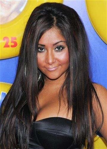 """FILE - In this June 23, 2010 file photo, television personality Nicole """"Snooki"""" Polizzi attends the premiere of """"Grown Ups"""" at the Ziegfeld Theatre in New York. (AP Photo/Evan Agostini, file) By Evan Agostini"""