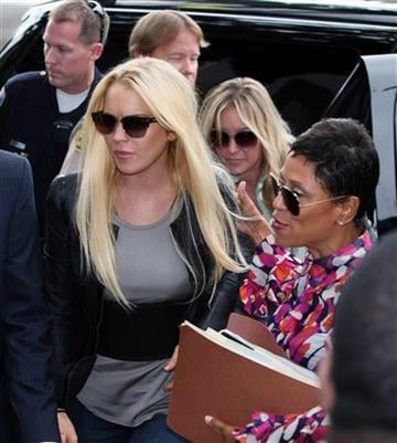 ** CORRECTS SPELLING OF ATTORNEY'S FIRST NAME TO SHAWN ** Lindsay Lohan, left, and attorney Shawn Chapman Holley arrive at the Beverly Hills courthouse in Beverly Hills, Calif., on Tuesday, July 20, 2010.  (AP Photo/Nick Ut) By Nick Ut