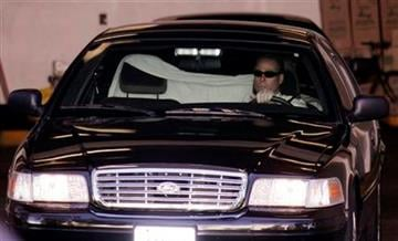 A car carrying Lindsay Lohan leaves a hearing at the Beverly Hills Courthouse in Beverly Hills, Calif., Friday, Sept. 24, 2010. (AP Photo/Nick Ut) By Nick Ut