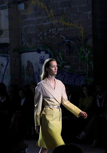 A model wears a creation designed by Belgium's Dries van Noten for his ready to wear spring/summer 2011 collection presented in Paris, Wednesday Sept. 29, 2010. (AP Photo/Christophe Ena) By Christophe Ena