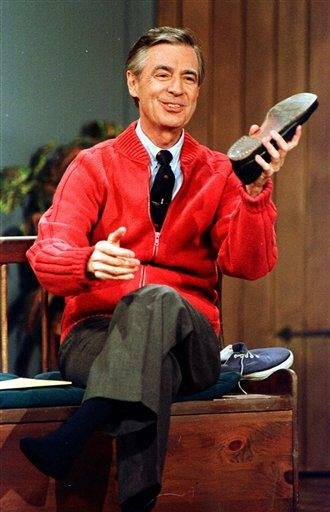 "FILE - This June 28, 1989 file photo shows Fred Rogers as he rehearses the opening of his PBS show ""Mister Rogers' Neighborhood"" during a taping in Pittsburgh. (AP Photo/Gene J. Puskar, File) By Gene J. Puskar"