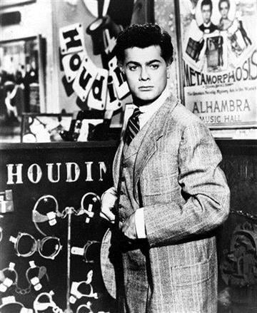"""FILE - Actor Tony Curtis portrays magician Harry Houdini in the 1953 Hollywood movie """"Houdini."""" Curtis has died at 85 according to the Clark County, Nev. coroner.  (AP Photo, File) By Afton Spriggs"""