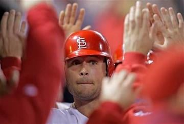 St. Louis Cardinals' Matt Holliday celebrates with teammates in the dugout after hitting a two-run home run in the sixth inning of a baseball game against the Pittsburgh Pirates, Monday, Sept. 27, 2010, in St. Louis.(AP Photo/Tom Gannam) By Tom Gannam