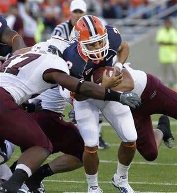 Illinois quarterback Nathan Scheelhaase (2) is sacked by Southern Illinois linebacker Stephen Franklin, left, during the first half of the NCAA college football game in Champaign, Ill., Saturday, Sept. 11, 2010. (AP Photo/Seth Perlman) By Seth Perlman