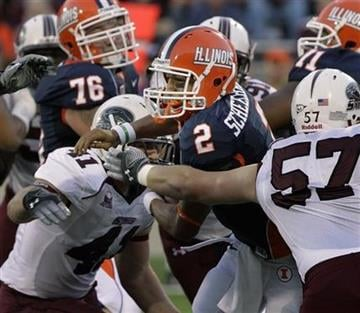 Illinois quarterback Nathan Scheelhaase (2) is sacked by Southern Illinois defensive end Kyle Russo, (57) during the first half of the NCAA college football game in Champaign, Ill., Saturday, Sept. 11, 2010. (AP Photo/Seth Perlman) By Seth Perlman