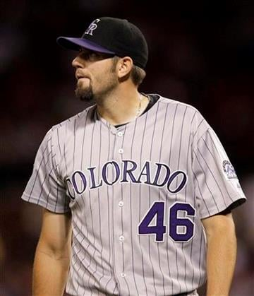 Colorado Rockies starting pitcher Jason Hammel walks off the field after the third inning of a baseball game against the St. Louis Cardinals on Thursday, Sept. 30, 2010, in St. Louis. (AP Photo/Jeff Roberson) By Jeff Roberson