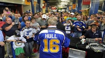 Former St. Louis Blues' Brett Hull does a radio interview as fans move in for a closer look, after being named Executive Vice President with the club,  at the Scottrade Center in St. Louis on September 9, 2013. UPI/Bill Greenblatt By BILL GREENBLATT
