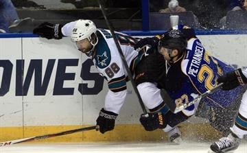 St. Louis Blues Alex Pietrangelo pulls down San Jose Sharks Brent Burns in the third period at the Scottrade Center in St. Louis on March 12, 2013.  St. Louis won the game 4-2.     UPI/Bill Greenblatt By BILL GREENBLATT