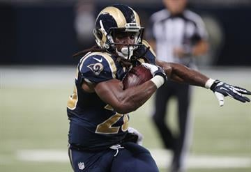 St. Louis Rams Daryl Richardson fights for extra yardage late in the fourth quarter against the Arizona Cardinals at the Edward Jones Dome in St. Louis on September 8, 2013. St. Louis won the game 27-24.    UPI/Bill Greenblatt By BILL GREENBLATT