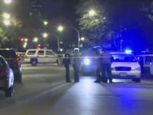 Chicago police investigate after a 17-year-old boy was shot and killed on the 4000 block of South Lake Park Avenue on Sept. 26, 2012. (Credit: CBS)