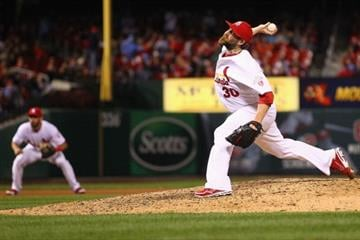 ST. LOUIS, MO - OCTOBER 1: Reliever Jason Motte #30 of the St. Louis Cardinals pitches against the Cincinnati Reds at Busch Stadium on October 1, 2012 in St. Louis, Missouri.  (Photo by Dilip Vishwanat/Getty Images) By Dilip Vishwanat