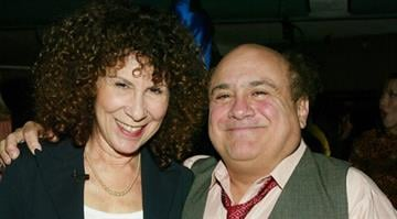 HOLLYWOOD, CA - MARCH 7:  Actress Rhea Perlman (L) and Actor Danny DeVito on stage at the 2nd Annual TV Land Awards held at The Hollywood Palladium, March 7, 2004 in Hollywood, California.  (Photo by Frank Micelotta/Getty Images) By Frank Micelotta