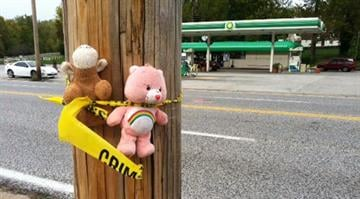 Mourners leave stuffed animals to remember two boys killed by a hit-and-run driver in Pagedale on Friday, Oct. 5. By Dan Mueller