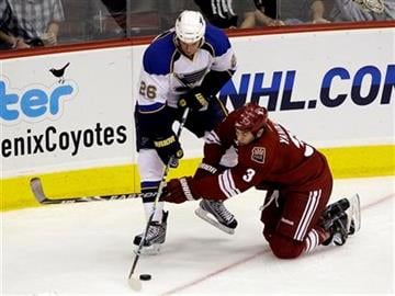 St. Louis Blues' B.J. Crombeen (26) battles Phoenix Coyotes' Keith Yandle (3) for the puck during the first period of an NHL hockey game Thursday, Oct. 15, 2009, in Glendale, Ariz. (AP Photo/Ross D. Franklin) By Ross D. Franklin