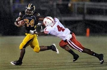 Missouri running back Derrick Washington, left, tries to get away from Nebraska safety Larry Asante during the first quarter of an NCAA college football game Thursday, Oct. 8, 2009, in Columbia, Mo. (AP Photo/L.G. Patterson) By L.G. Patterson