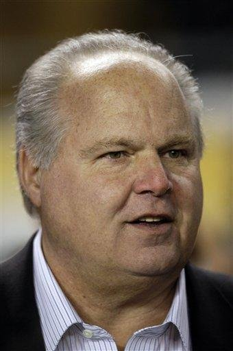 FILE - In this Jan 18, 2009, file photo, talk show host Rush Limbaugh is interviewed on the sidelines before the start of the NFL AFC championship football game in Pittsburgh.  (AP Photo/Rob Carr, file) By Rob Carr