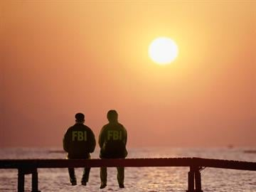 Two agents peer into the sunset. By Davy Belo Producer