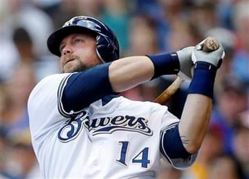 ALTERNATE CROP - Milwaukee Brewers' Casey McGehee(14) watches his two-run home run in the third inning of a baseball game against the St. Louis Cardinals, Wednesday, Aug. 3, 2011, in Milwaukee. (AP Photo/Jeffrey Phelps) By Jeffrey Phelps