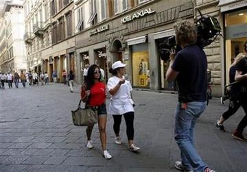 "In this Monday, May 23, 2011 photo members of MTV reality show ""Jersey Shore"" Nicole ""Snooki"" Polizzi, left, and Nicole ""Deena"" Cortese walk along Via dei Calzaiuoli, in Florence, Italy. (AP Photo/Francesco Bellini) By Francesco Bellini"