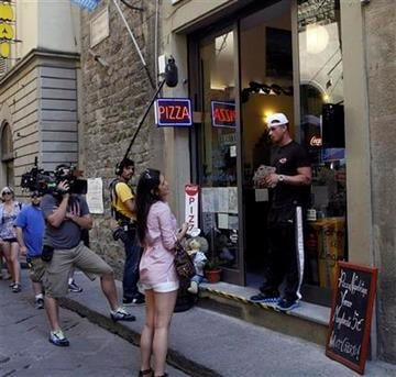"""In this Monday, May 23, 2011 photo member of MTV reality show """"Jersey Shore"""" Paul """"Pauly D"""" Del Vecchio, right, stands outside O' Vesuvio pizzeria in Florence, Italy. (AP Photo/Francesco Bellini) By Francesco Bellini"""